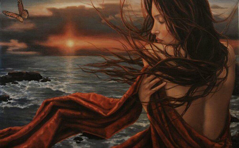 Mulher vendo o por do sol e refletindo sobre deixar ir quem nunca esteve
