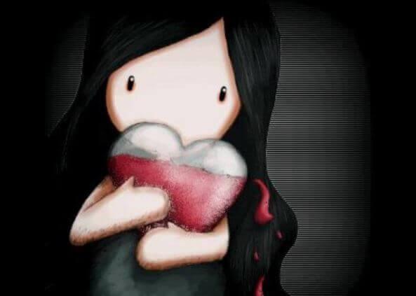 menina agarrando coração