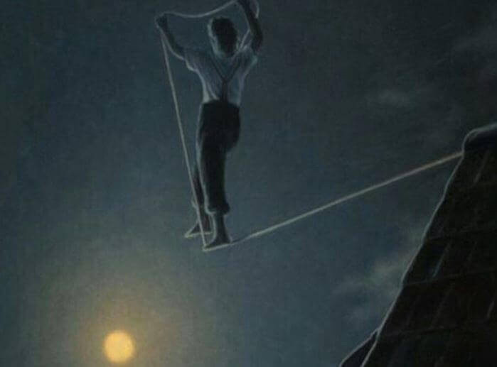 Homem caminhando em corda bamba