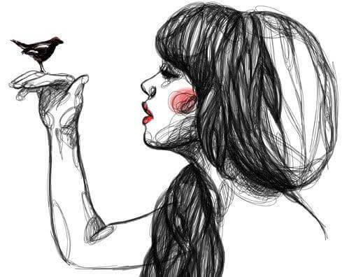Jovem com pássaro na mão