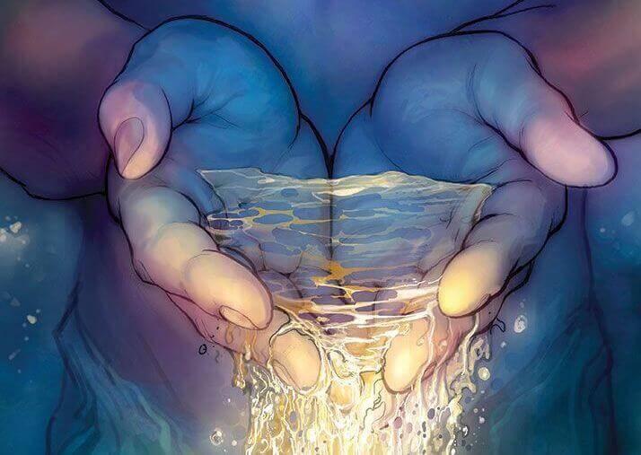 Mãos com água brilhante
