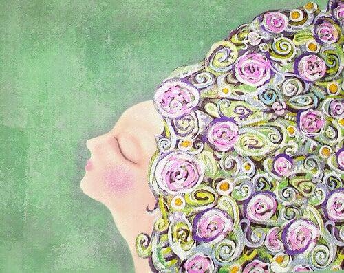 Mulher com olhos fechados e cabelo de flores