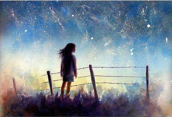 Jovem envolta em um céu estrelado