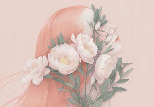 Mulher envolta em flores rosadas
