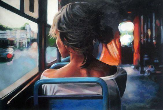 Mulher sentada de costas em um ônibus