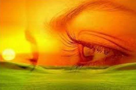 Olho reflexo laranja verde