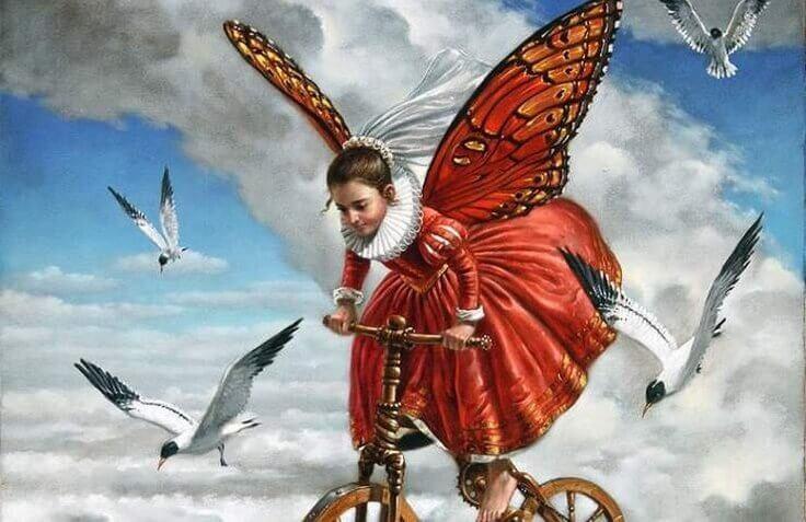 menina com bicicleta e asas de borboleta