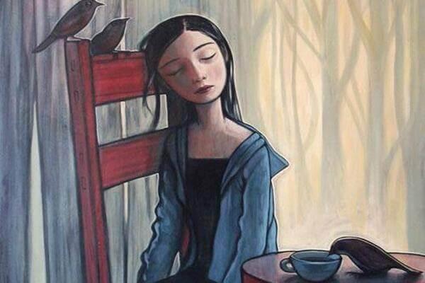 menina-sentada-com-expressão-triste