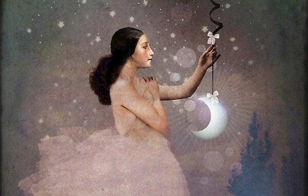 mulher-segurando-uma-lua