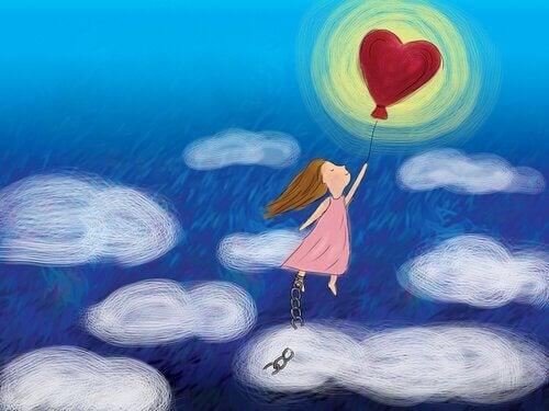 Menina voando com balão