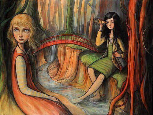 Meninas sentadas perto do rio