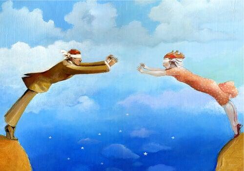 casal com olhos vendados unido pelo Cupido