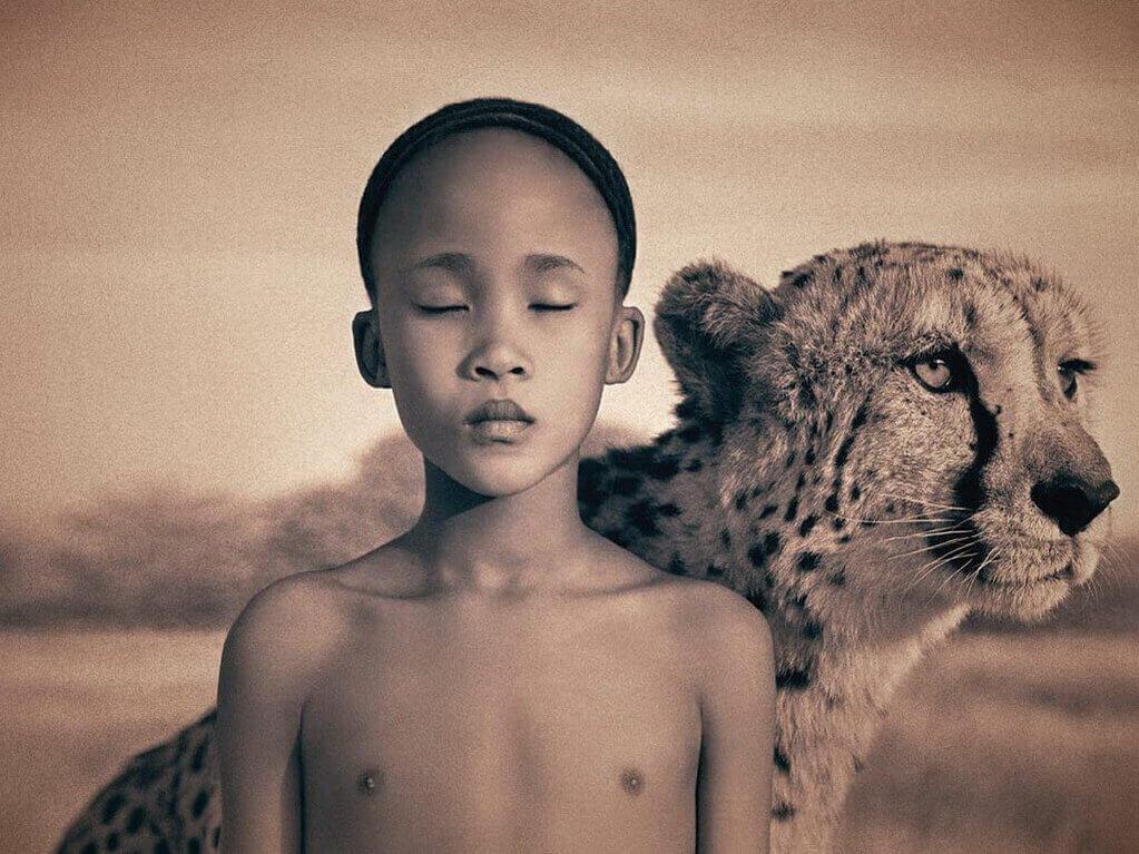 criança-com-onça-budismo