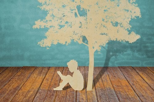 Criança-lendo-debaixo-de-uma-árvore