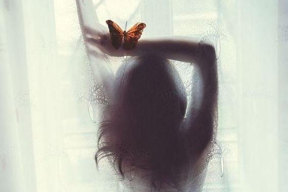 Mulher com borboleta