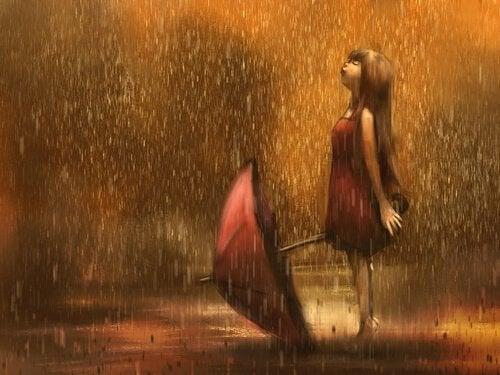 menina-triste-na-chuva
