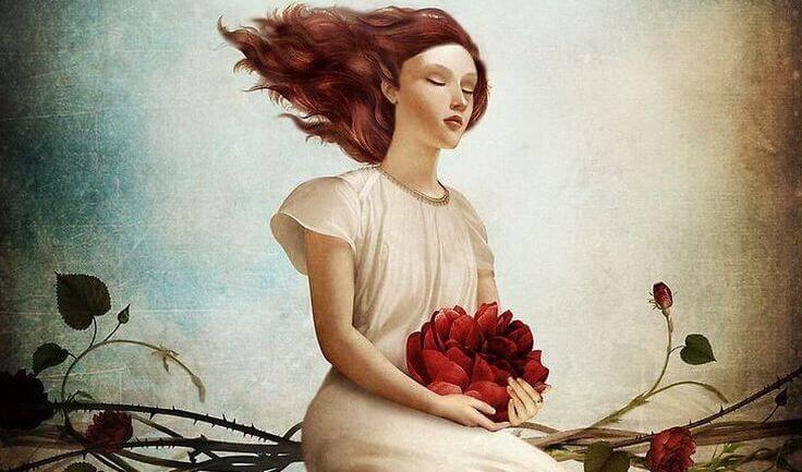 mulher-flor-nas-maos