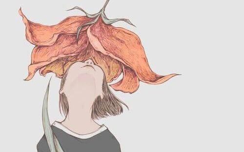 menina-olhando-flor
