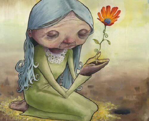 senhora-idosa-segurando-flor