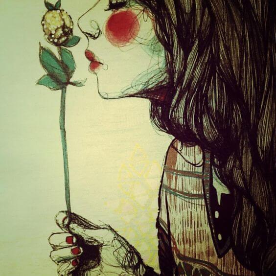 menina-cheirando-flor
