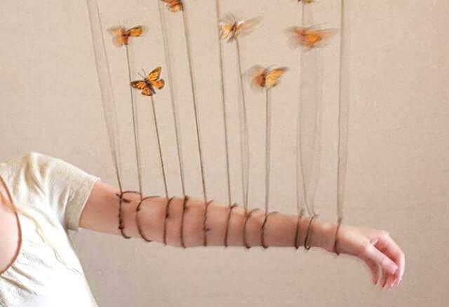 borboletas-presas-braço