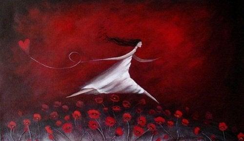 mulher-campo-de-flores-vermelhas