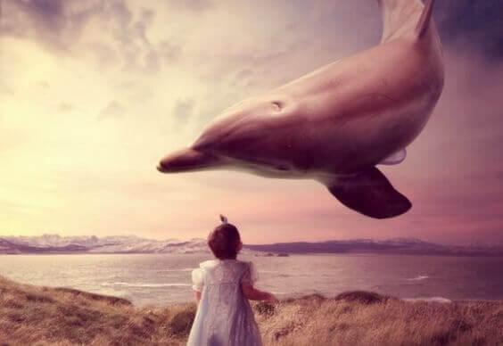 crianca-vendo-golfinho-voando