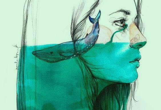 perfil-mulher-com-baleia-em-mar