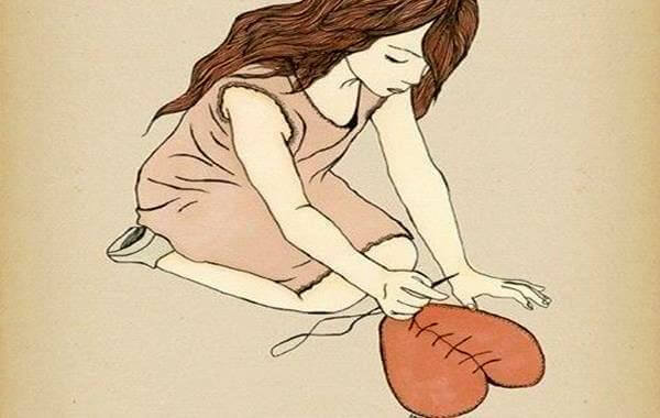 mulher-costurando-coracao
