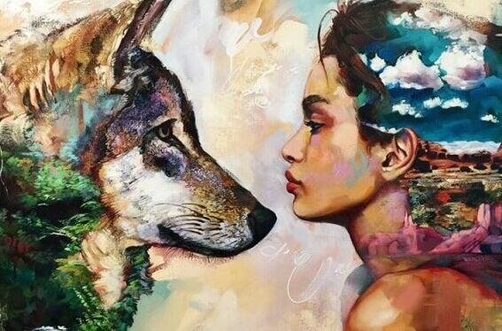 Mulher e lobo de frente um para o outro