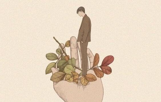 Homem em mão com folhas coloridas