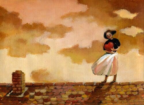 Mulher segurando coracao em telhado