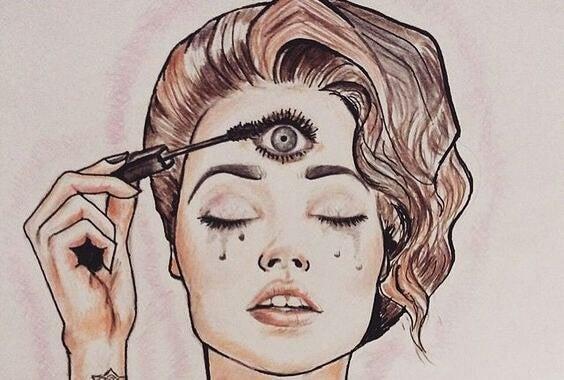 Mulher maquiando terceiro olho