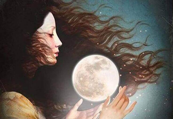Mulher com a lua entre as mãos