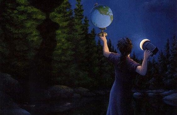 Homem olhando globo terrestre com lanterna