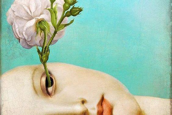 Mulher com flor saindo de seu olho