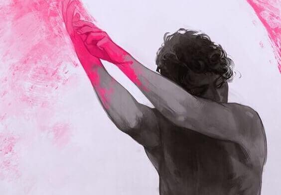 Homem com mãos cor-de-rosa