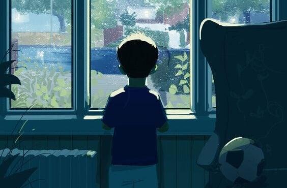Menino olhando pela janela
