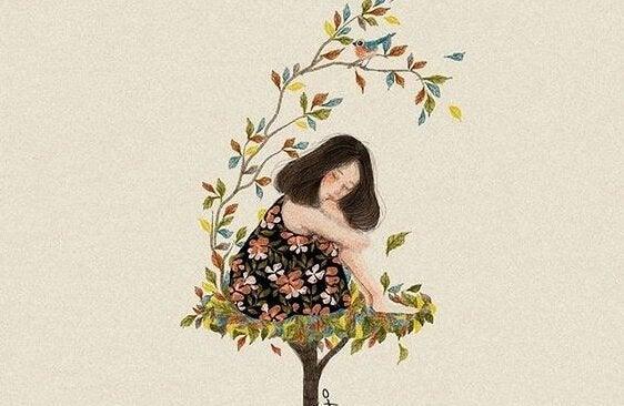 Menina sentada em ninho de folhas