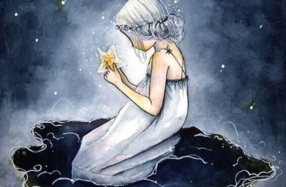 Menina segurando estrela em solidão