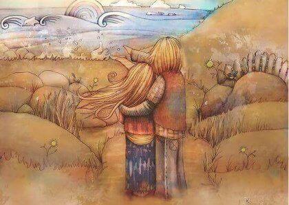 Casal apaixonado observando o mar