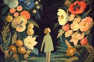 Menina caminhando em jardim de flores