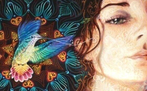 Mulher com beija-flor colorido