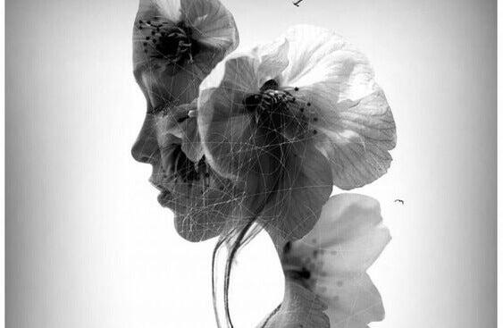 Rosto feminino ilustrado com flor