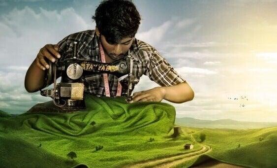 Homem costurando paisagem