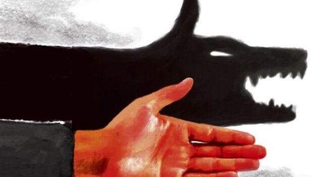 Mão fazendo sombra em forma de lobo