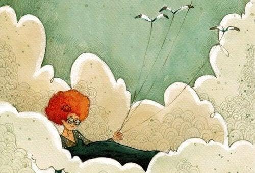 Mulher segurando pássaros por cordas