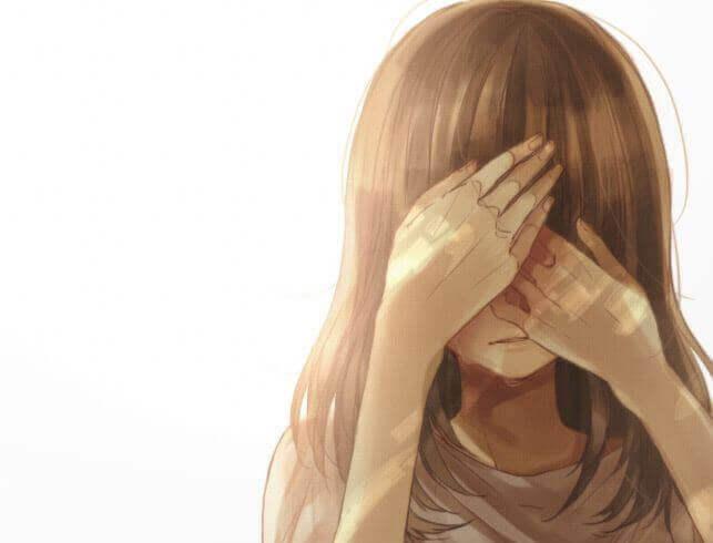 Menina cobrindo seu rosto