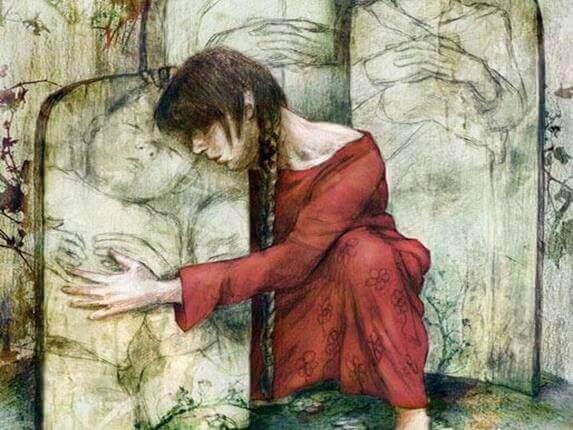 Mulher abraçando pedra com criança desenhada