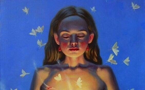 Mulher de olhos fechados com borboletas ao redor